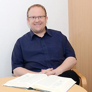 T. Küster